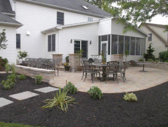 backyard after landscape renovation with hardscape patio and walways