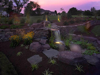 fish pond with waterfall and lighting